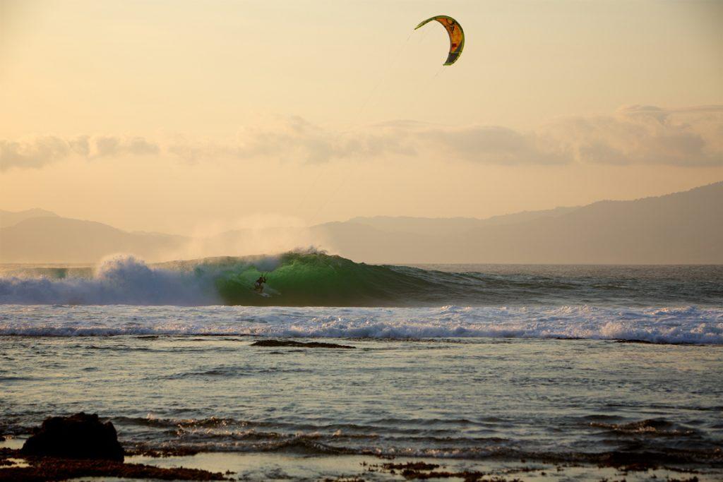 Reo Stevens kitesurfing barrel Indonesia by Jason Wolcott