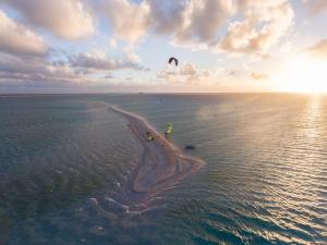 Sunset kiteboarding session tuamotus